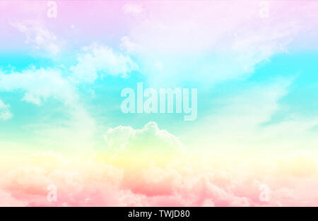 White fluffy thick clouds on a blue sky painted in the color of the rainbow. Color toning. Natural background wallpaper. - Stock Photo