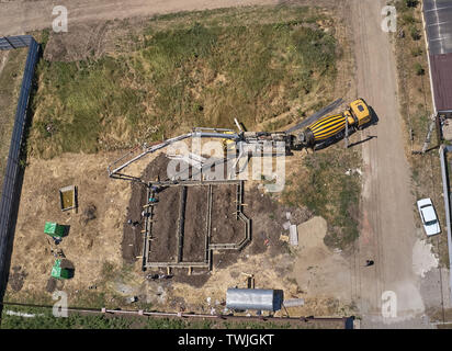 concrete pump pour the Foundation of the house - Stock Photo