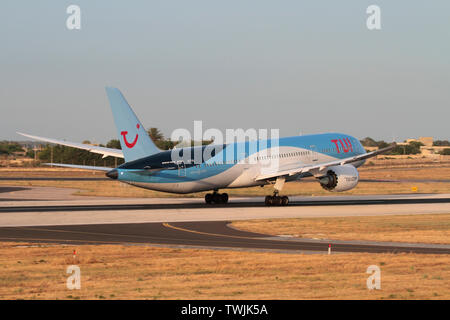 TUI Boeing 787-9 Dreamliner widebody commercial airliner taking off from the runway at Malta International Airport - Stock Photo