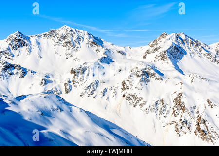 View of ski slope and amazing Austrian Alps mountains in beautiful winter snow, Serfaus Fiss Ladis, Tirol, Austria - Stock Photo