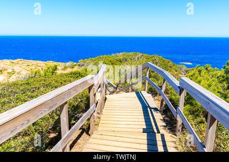 Coastal wooden walkway to sea near Sa Tuna village, Costa Brava, Spain - Stock Photo