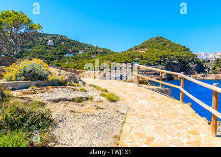 Coastal walkway to beach near Sa Tuna village, Costa Brava, Spain - Stock Photo