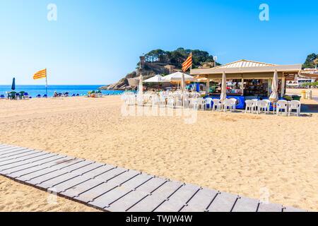 TOSSA DE MAR, SPAIN - JUN 3, 2019: Restaurant on sandy beach in Tossa de Mar town, Costa Brava, Spain. - Stock Photo