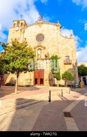 Facade of old church in Tossa de Mar town, Costa Brava, Spain - Stock Photo