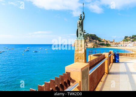 TOSSA DE MAR, SPAIN - JUN 6, 2019: Monument to Minerva on coastal promenade in Tossa de Mar. This sculpture was designed by Frederic Mares i Deulovol - Stock Photo