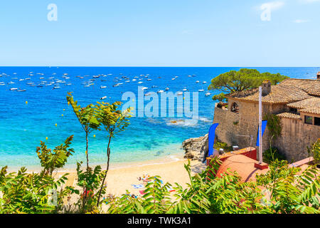 Amazing beach in Calella de Palafrugell, scenic fishing village with white houses and sandy beach with clear blue water, Costa Brava, Catalonia, Spain - Stock Photo