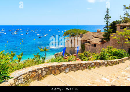 Steps to beach in Calella de Palafrugell, scenic fishing village with white houses and sandy beach with clear blue water, Costa Brava, Catalonia, Spai - Stock Photo