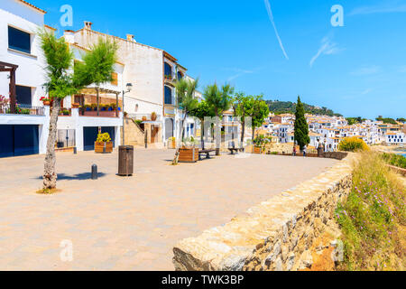 Houses on promenade in Calella de Palafrugell, scenic fishing village with white houses and sandy beach with clear blue water, Costa Brava, Catalonia, - Stock Photo