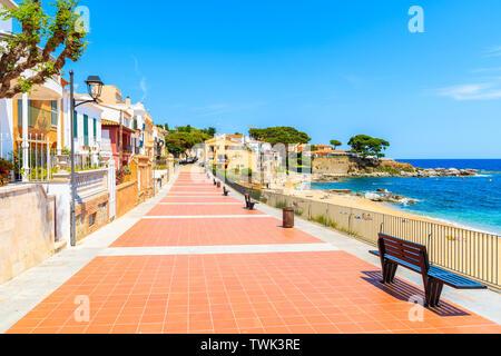 Colorful houses on coastal promenade on Canadell beach in Calella de Palafrugell village, Costa Brava, Catalonia, Spain - Stock Photo