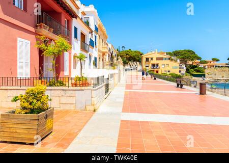 CALELLA DE PALAFRUGELL, SPAIN - JUN 6, 2019: Colorful houses on coastal promenade on Canadell beach in Calella de Palafrugell village, Costa Brava, Ca - Stock Photo