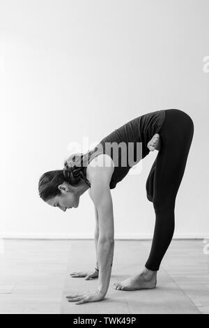 forward bend female standing on one leg bending forward