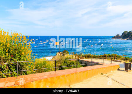 Coastal promenade in Calella de Palafrugell, scenic fishing village with white houses and sandy beach with clear blue water, Costa Brava, Catalonia, S - Stock Photo