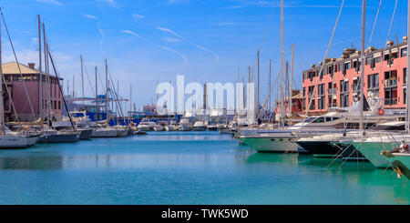 GENOA, ITALY - MARCH 9, 2019: View of Old seaport with the lighthouse and luxury yachts in Genoa, Italy - Stock Photo