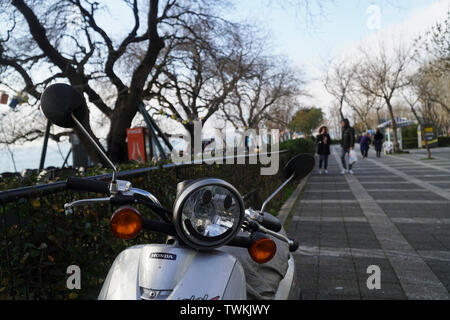 Istanbul, Turkey - February 16, 2019 : There is a Honda motor scooter with a smiling face on the headlight at The Istanbul, Moda District with beautif Stock Photo