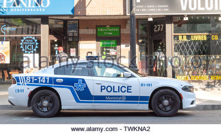 Montreal, Quebec, Canada-June 11, 2017 NEW: Police car parked in the Saint Catherine street during the morning hours. - Stock Photo