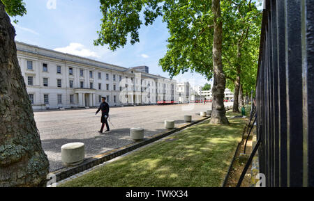 London, UK, June 2018. Along the Birdcage Walk in the Wellington Barracks courtyard, the royal guards prepare for the ceremonial of changing of the gu - Stock Photo
