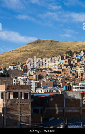 Views across the rooftops in Puno, Peru, South America, - Stock Photo