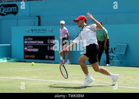 Queen Club, London, UK. 21st June, 2019. The ATP Fever-Tree Tennis Tournament; Diego Schwartzman (ARG) returns Daniil Medvedev (RUS) serve Credit: Action Plus Sports/Alamy Live News - Stock Photo