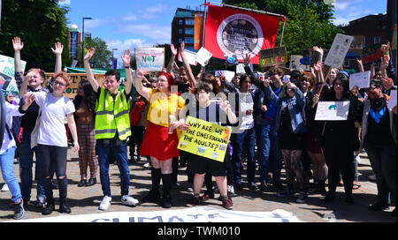 Young people lobby for action to prevent climate change at the  Manchester Youth Strike 4 Climate protest on June 21, 2019, in Manchester, uk. The group marched from St Peter's Square in the city centre to the University of Manchester. One of their demands is for the University to divest itself of investments in fossil fuels. - Stock Photo