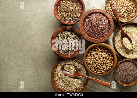 Various of healthy seeds and cereals - sesame, flax seed, chia seeds, soybean, buckwheat and oats. Copy space. - Stock Photo