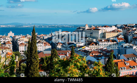 Lisbon, Portugal cityscape overlooking Baixa downtown area. Visible landmarks include: Rua Augusta Triumphal Arch, Rossio, Santa Justa Elevator - Stock Photo