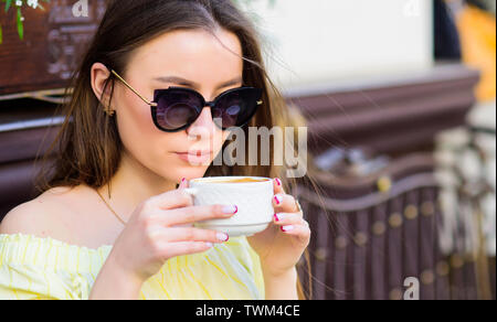 good morning. Breakfast time. stylish woman in glasses drink coffee. girl relax in cafe. Business lunch. morning coffee. Waiting for date. summer fash - Stock Photo