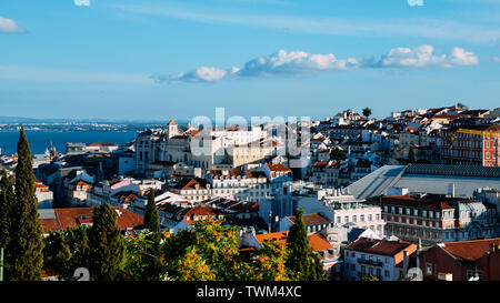 Lisbon, Portugal cityscape overlooking Baixa downtown area. Visible landmarks include: Rossio Square, Santa Justa Elevator and Chiado with Tagus River - Stock Photo