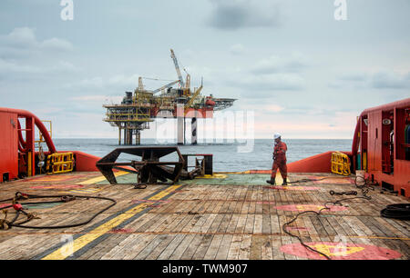 marine crew preparing anchor on deck  before deploy the anchor to sea - Stock Photo