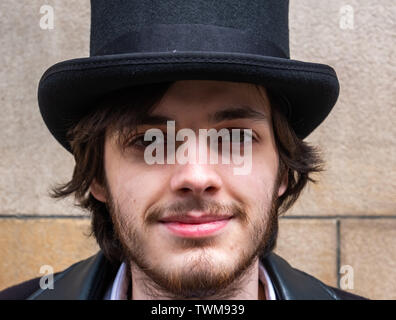 Glasgow, Scotland, UK. 21st June, 2019. UK Weather. A young man called Ian dressed as a Victorian Gentleman with a top hat, enjoys a sunny day in Glasgow. Credit: Skully/Alamy Live News - Stock Photo