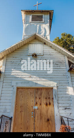 Old abandoned Florida church with locked wooden doors - Stock Photo