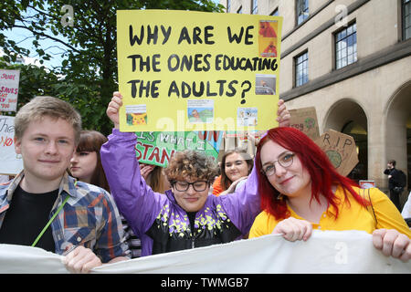 Manchester, UK, 21st June, 2019.School students strike for climate march to Manchester University calling for them to divest from funding organisations that contribute to climate change.  Manchester.  Credit: Barbara Cook/Alamy Live News - Stock Photo