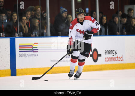 Melbourne, Victoria, Australia. 21st June 2019. 2019 Ice Hockey Classic, Canada versus USA; James Bettauer of Canada moves the puck forward Credit: Action Plus Sports Images/Alamy Live News - Stock Photo