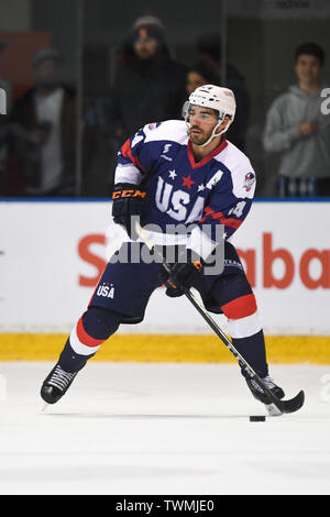 21st June 2019, O'Brien Group Arena, Melbourne, Victoria, Australia; 2019 Ice Hockey Classic, Canada versus USA; Jake Kulevich of USA brings the puck out of defence Credit: Action Plus Sports Images/Alamy Live News - Stock Photo