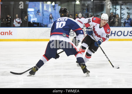 Melbourne, Victoria, Australia. 21st June 2019. 2019 Ice Hockey Classic, Canada versus USA; Shane Heffernan of Canada moves the puck forward Credit: Action Plus Sports Images/Alamy Live News - Stock Photo