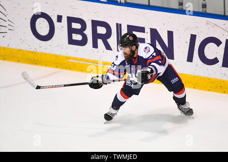 Melbourne, Victoria, Australia. 21st June 2019. 2019 Ice Hockey Classic, Canada versus USA; Josh Harris of USA passes the puck Credit: Action Plus Sports Images/Alamy Live News - Stock Photo