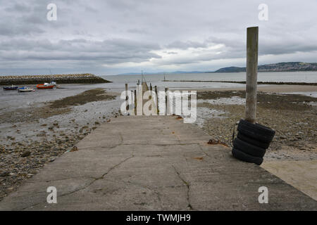 Rhos-on-Sea in very mixed weather rain mist andcloud. - Stock Photo