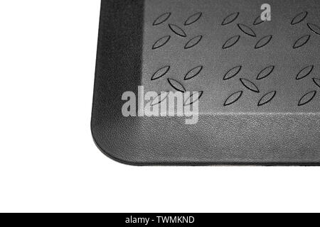 Black rubber mat with ornaments close up. - Stock Photo