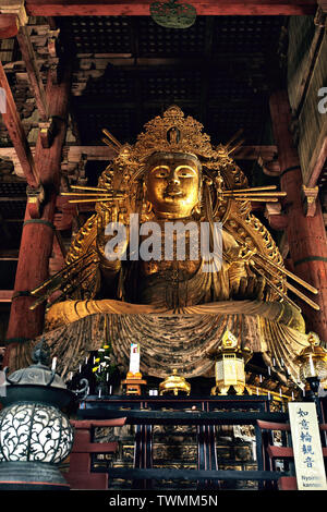 View of the giant Buddha inside the Daibutsuden, Great Buddha Hall, of the Todaiji Temple, in Nara, Japan - Stock Photo