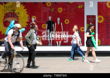London, UK. 21st June, 2019. Shoppers walk past the Debenhams store on Oxford Street as summer sales begin. Many departmental stores are offering huge discounts as they face competition from online shopping. Credit: Dinendra Haria/SOPA Images/ZUMA Wire/Alamy Live News - Stock Photo