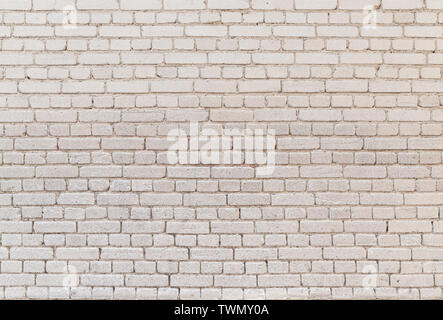 High resolution full frame background of detailed old pale brick wall. - Stock Photo