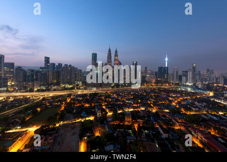 Kuala lumpur cityscape. Panoramic view of Kuala Lumpur city skyline during sunrise viewing skyscrapers building in Malaysia. - Stock Photo