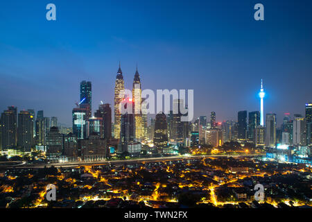 Kuala lumpur cityscape. Panoramic view of Kuala Lumpur city skyline during sunrise viewing skyscrapers building and Petronas twin tower in Malaysia. - Stock Photo