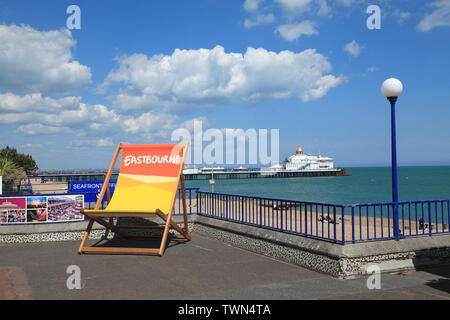 Deckchair on Eastbourne seafront promenade , East Sussex, UK - Stock Photo