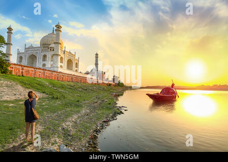 Taj Mahal at sunset with view of boat on river Yamuna at Agra India. Taj Mahal is a UNESCO World Heritage site and mughal architecture masterpiece