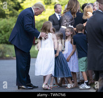 Washington, District of Columbia, USA. 21st June, 2019. June 21, 2019 - Washington, DC, United States: United States President Donald J. Trump greets guests during the Congressional Picnic for Members of Congress and their families at The White House Credit: Chris Kleponis/CNP/ZUMA Wire/Alamy Live News - Stock Photo
