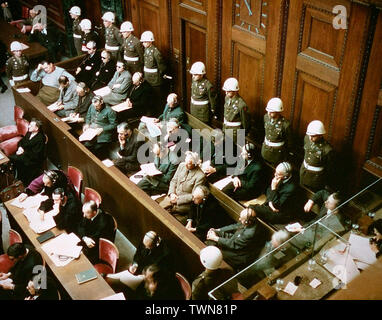 View of the defendants in the dock at the International Military Tribunal trial of war criminals in Nuremberg, Bavaria, Germany. November 1945 - Stock Photo