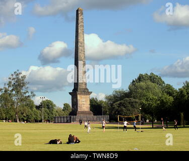 Glasgow, Scotland, UK 21st  June, 2019. UK Weather: Sunny in the city on the longest day or the summer solstice as locals enjoy the lawns at Cleopatra's needle or the nelson monument Glasgow Green park. Credit: Gerard Ferry/ Alamy Live News - Stock Photo