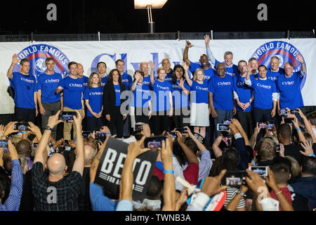 Columbia, United States. 21st June, 2019. Democratic presidential hopefuls stand together onstage at the conclusion of the Jim Clyburn World Famous Fish Fry June 21, 2019 in Columbia, South Carolina. The event kicks off the South Carolina Democratic Convention weekend and 22 Democratic candidates plan to attend the event. Credit: Planetpix/Alamy Live News - Stock Photo