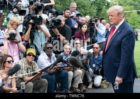Washington, United States Of America. 18th June, 2019. President Donald J. Trump talks with reporters along the driveway of the South Lawn of the White House Tuesday, June 18, 2019, prior to beginning his trip to Orlando, Fla People: President Donald Trump Credit: Storms Media Group/Alamy Live News - Stock Photo