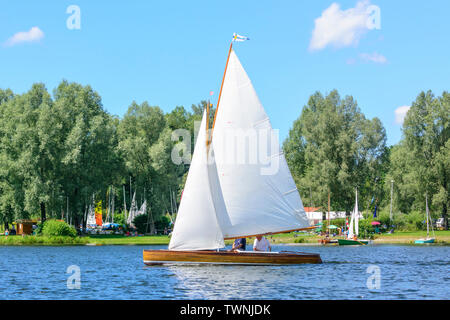 Sailing on inland lake in summertime - Stock Photo